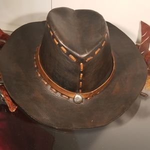 Black leather cowboy hat with brown trim
